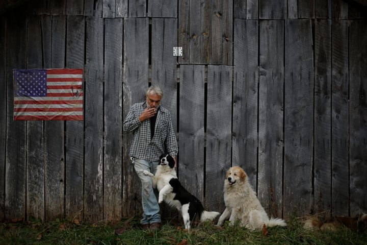 Jeff Fletcher, standing near his mobile home in Jackson, Kentucky, was uninsured until he enrolled in Obamacar