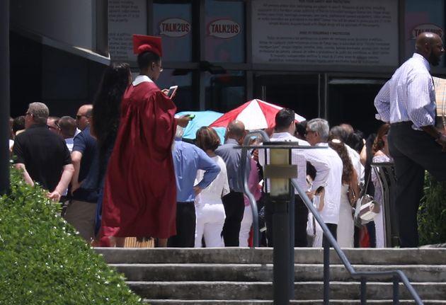 A graduate walks as seniors from Marjory Stoneman Douglas High school attend their graduation ceremonyon