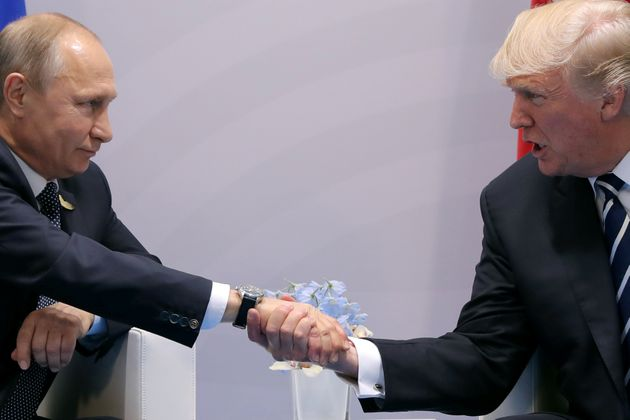 Trump shakes hands with Russian President Vladimir Putin during the their bilateral meeting at the...