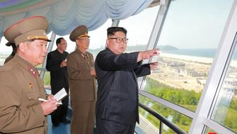 FILE PHOTO North Korean leader Kim Jong Un inspects the construction site of the Wonsan-Kalma coastal tourist area as Kim Su-gil (3rd L), newly appointed director of the General Political Bureau of the Korean People's Army, looks on, in this undated photo released by North Korea's Korean Central News Agency (KCNA) in Pyongyang. KCNA/via REUTERS/Files ATTENTION EDITORS - THIS PICTURE WAS PROVIDED BY A THIRD PARTY. REUTERS IS UNABLE TO INDEPENDENTLY VERIFY THE AUTHENTICITY, CONTENT, LOCATION OR DATE OF THIS IMAGE. NO THIRD PARTY SALES. SOUTH KOREA OUT.