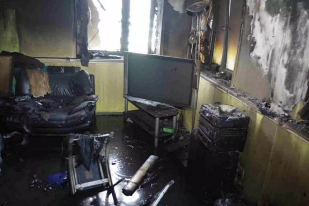 The TV and sofas remain in place, despite the deadly