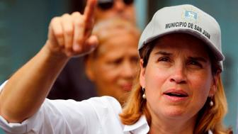 The Mayor of San Juan, Carmen Yulin Cruz points as she visits the Playita community with US Sen. Bernie Sanders (I- VT) in San Juan, Puerto Rico, on October 27, 2017. More than 73,000 people have fled emergency conditions at home for Florida since Hurricane Maria devastated the US territory in the Caribbean. / AFP PHOTO / Ricardo ARDUENGO        (Photo credit should read RICARDO ARDUENGO/AFP/Getty Images)