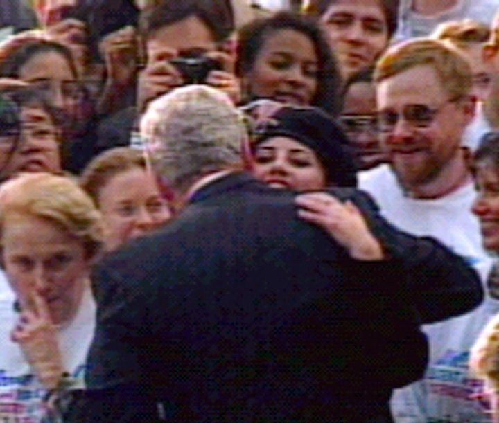 Former White House intern Monica Lewinsky hugs President Clinton at the White House, November 6 1996 during a ceremony gather