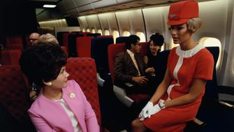 A United Airlines flight attendant talks with a passenger in a simulated passenger compartment of a Douglas DC-10. (Photo by Dean Conger/Corbis via Getty Images)