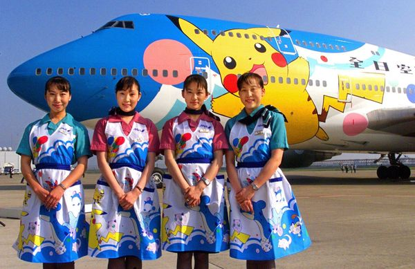 Flight attendants for Japan's All Nippon Airways introduce its Pokemon jet, which began domestic operati