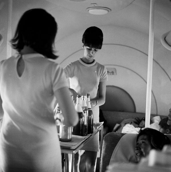 Flight attendants serving beverages on an LAN Airways flight in the 1960s.