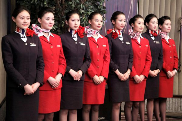 At a ceremony marking China Eastern Corp.'s acquisition of Shanghai Airlines Co., flight attendants from the two airlin