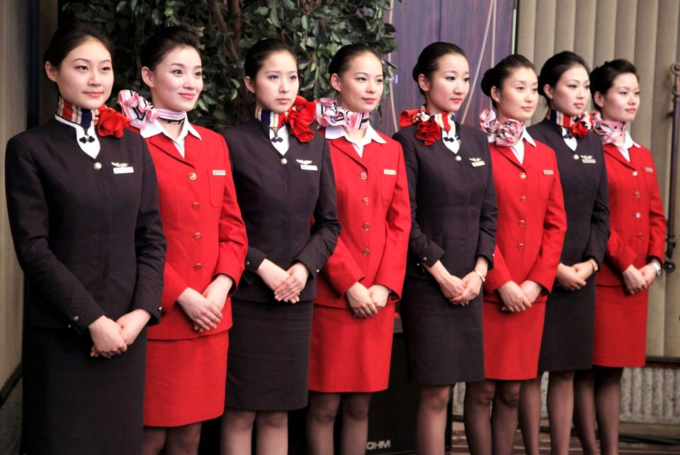 47 Stunning Photos Of Flight Attendant Uniforms Over The
