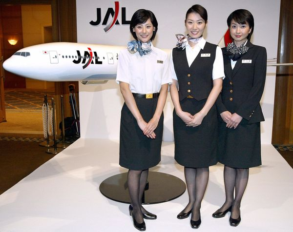 Japan Airlines flight attendants wearing newly designed uniforms in Tokyo in 2003.