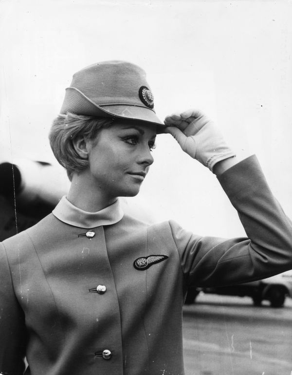 Felicity Downer models a new British United Airways stewardess uniform at Gatwick Airport outside London in 1967.