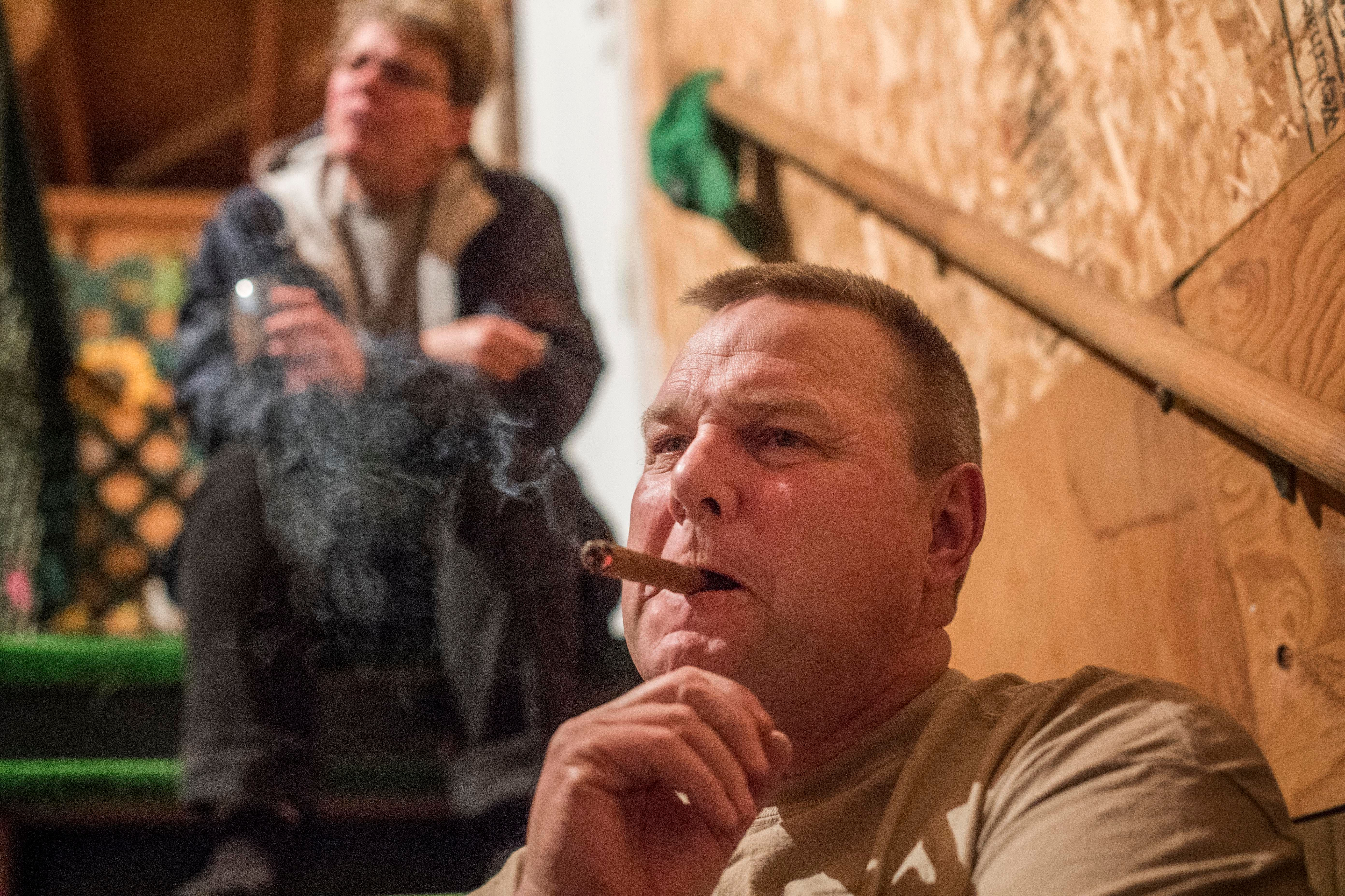 BIG SANDY, MONTANA - After a long day of farm work, Sharla Tester and Senator Jon Tester (D-MT) enjoy after dinner conversation, and a cigar, in their garage on their farm in Big Sandy, Montana Thursday April 13, 2017. (Photo by Melina Mara/The Washington Post via Getty Images)