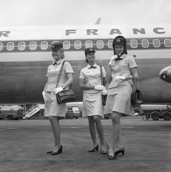Three Air France air hostesses at London's Heathrow Airport wearing new uniforms designed by Balenciaga in 1969.