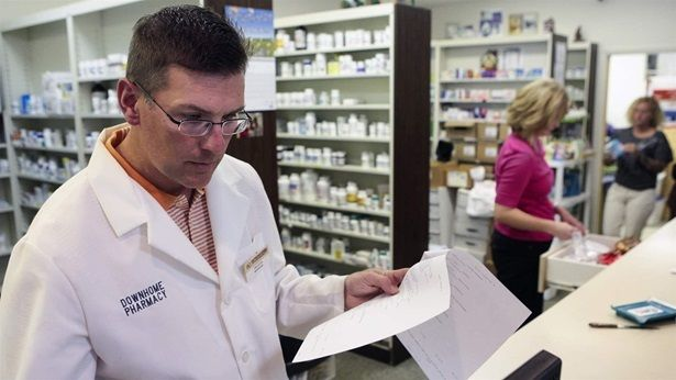 "Pharmacists working at DownHome Pharmacy in Roanoke, Virginia. Virginia recently enacted a ban on ""gag rules,"" which prevent"