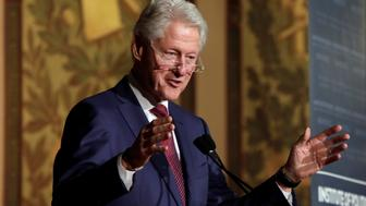 Former President Bill Clinton delivers a keynote address at Georgetown University Institute of Politics and Public Service symposium to mark the 25th anniversary of President Clinton's 1992 presidential election victory in Washington, U.S., November 6, 2017. REUTERS/Yuri Gripas