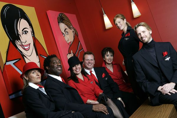 Delta flight attendants modeling new uniforms designed by Richard Tyler in 2006.