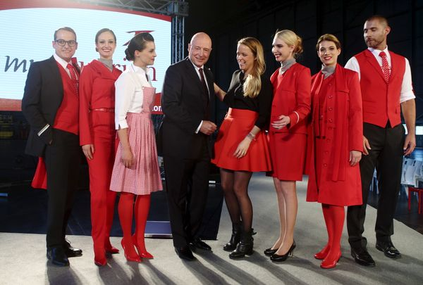 Austrian Airlines flight attendants with company executive Kay Kratky and fashion designer Marina Hoermanseder afte