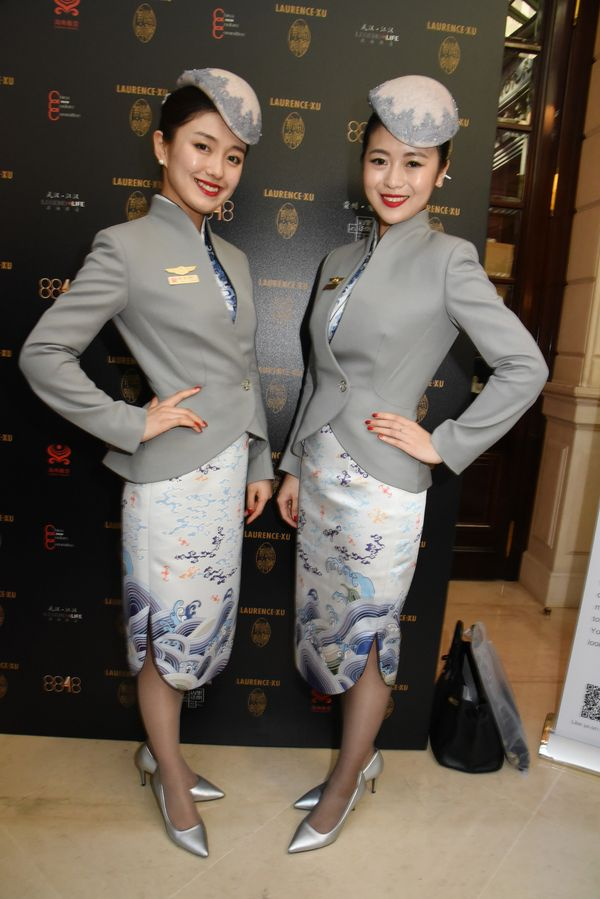 Models wear Hainan Airlines stewardess uniforms designed by Laurence Xu in 2017 in Paris.