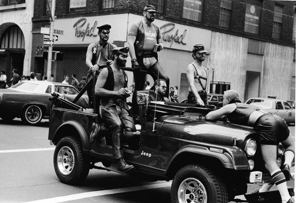 A group of men ride in a truck at the intersection of 32nd Street and Fifth Avenue during the annual gay Pride parade in