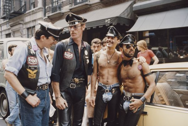 A group of men relax on the street during the gay Pride parade in New York City, June 1982.