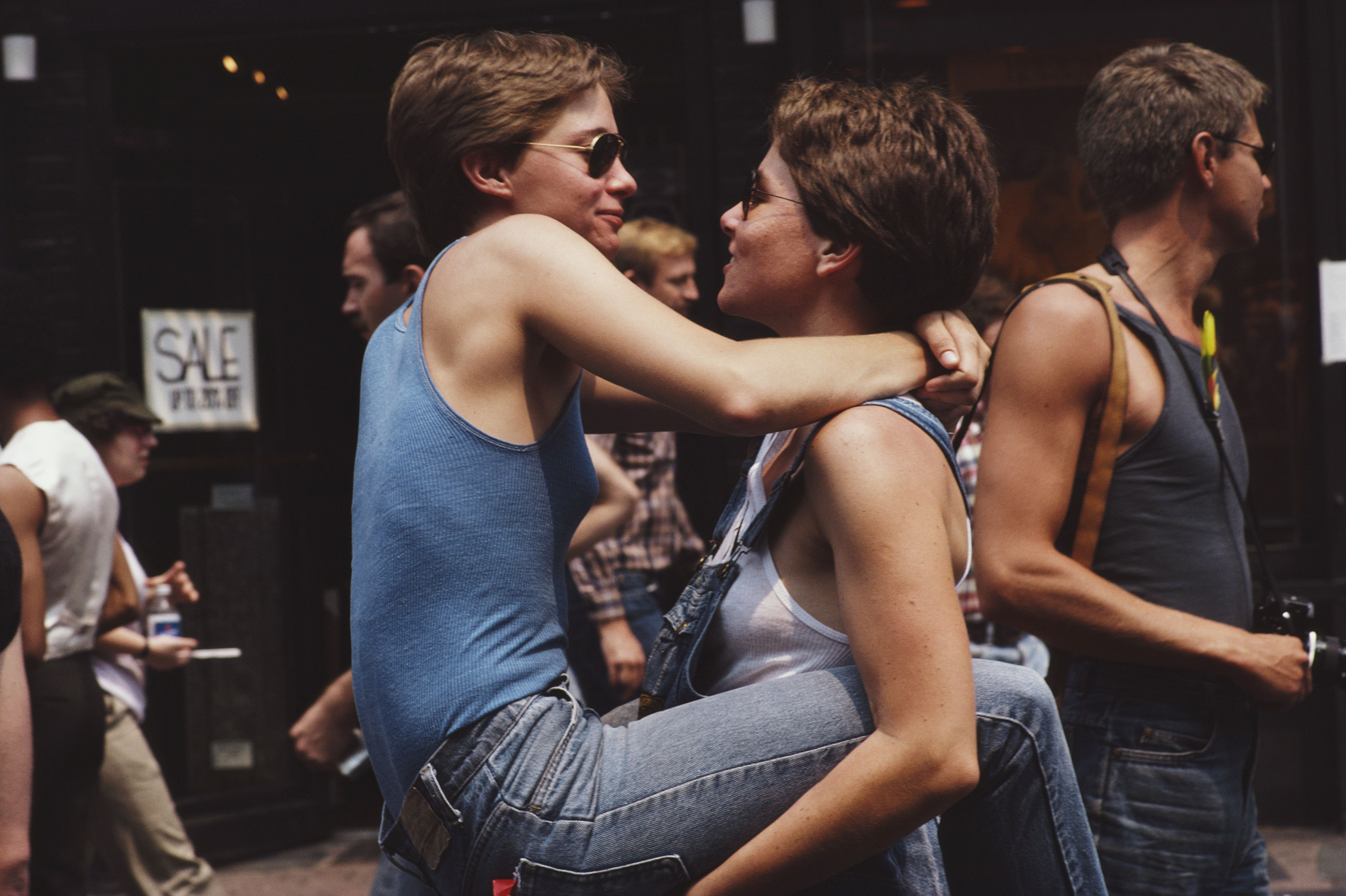 Two women embrace during the gay Pride parade in New York City,June 1982.