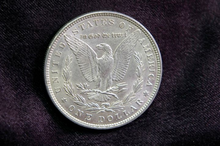 "A silver dollar from 1887. ""In God we trust"" started appearing on U.S. coins in 1864, partly in reactio"