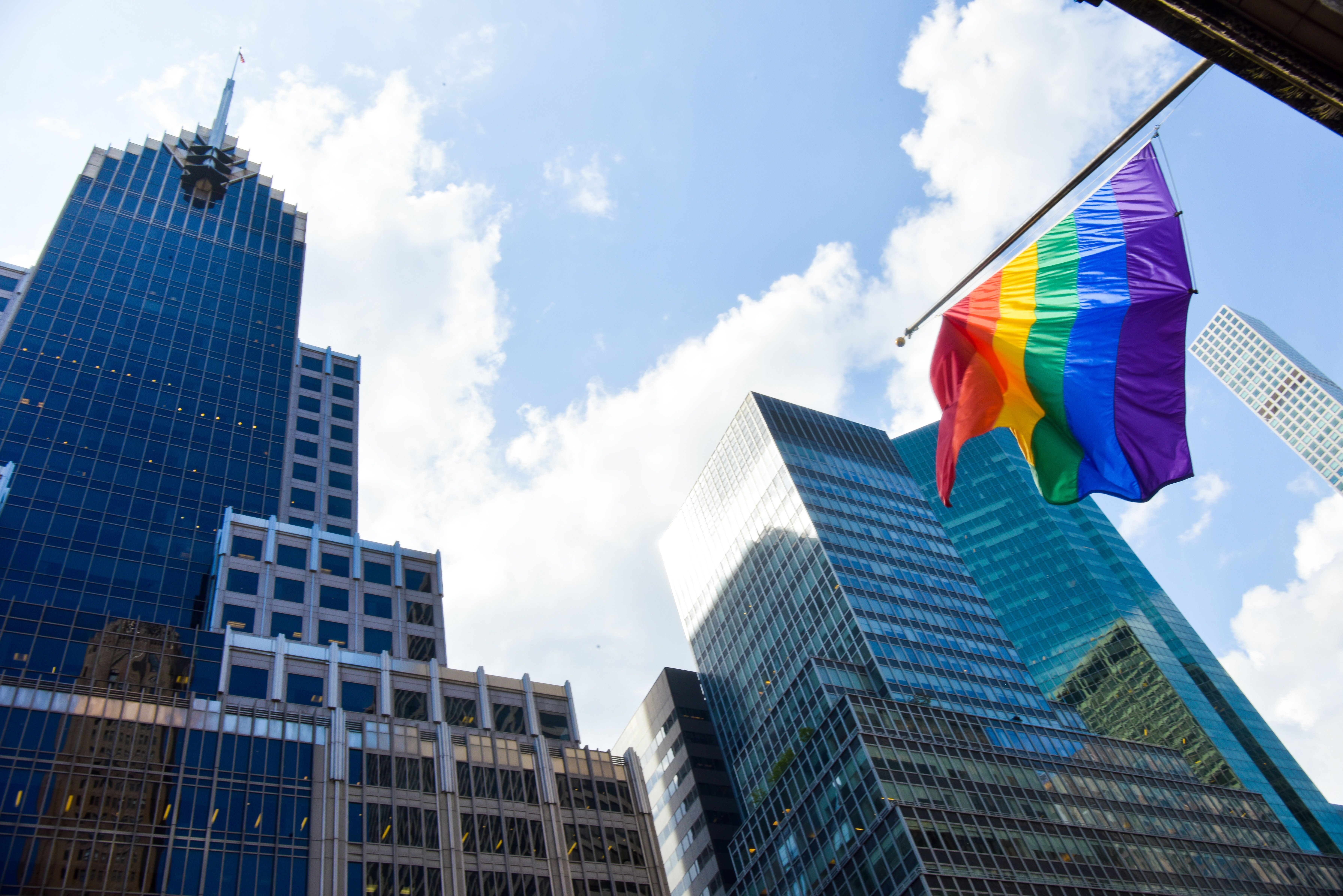 An LGBTQ pride flag waves in midtown Manhattan, New York.