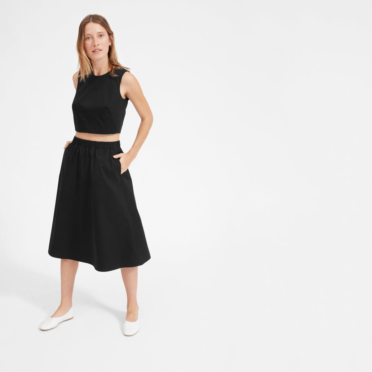 """Get the matchingset<a href=""""https://www.everlane.com/products/womens-clean-ctn-a-line-skirt-black?collection=wome"""