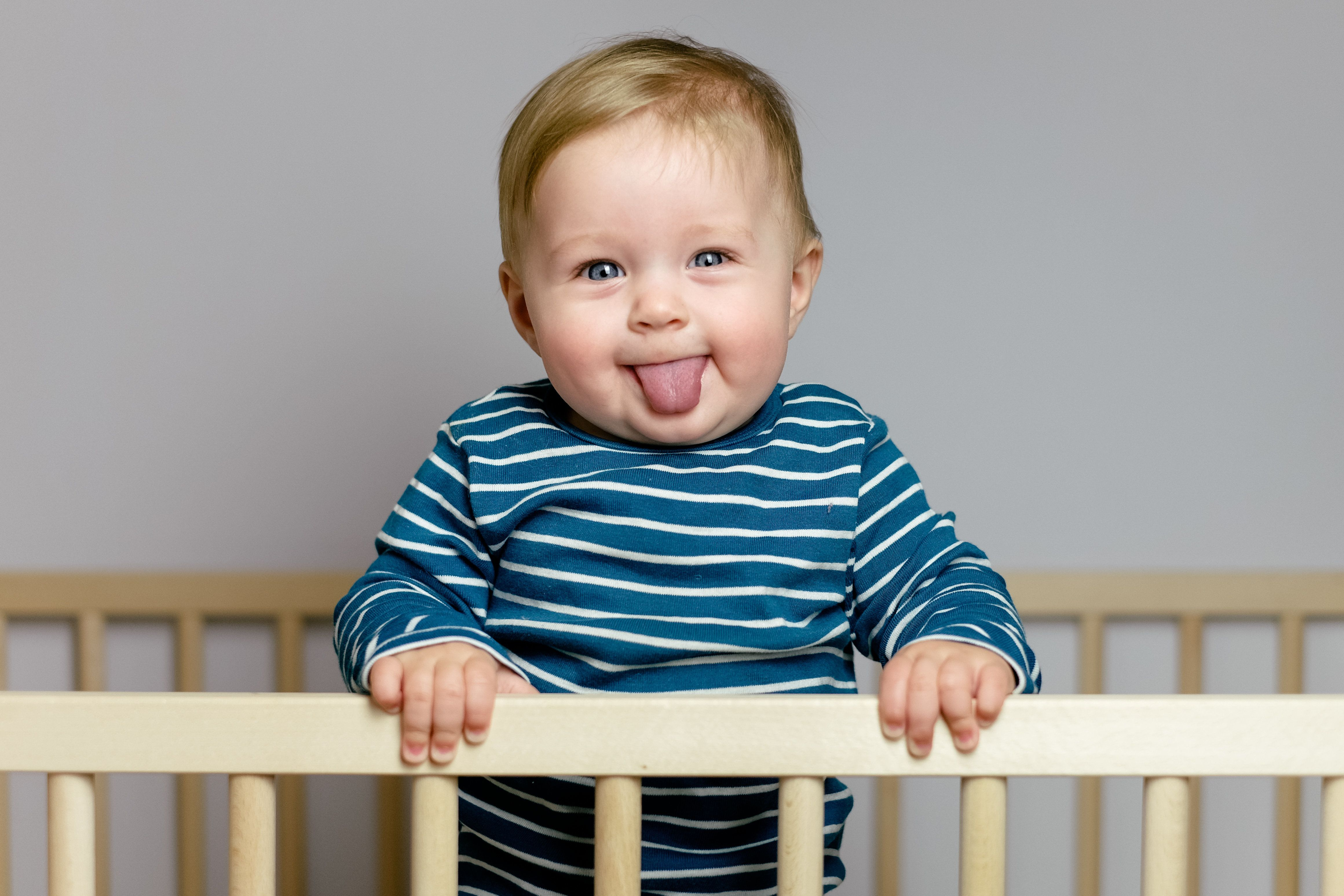 Baby playing in the crib