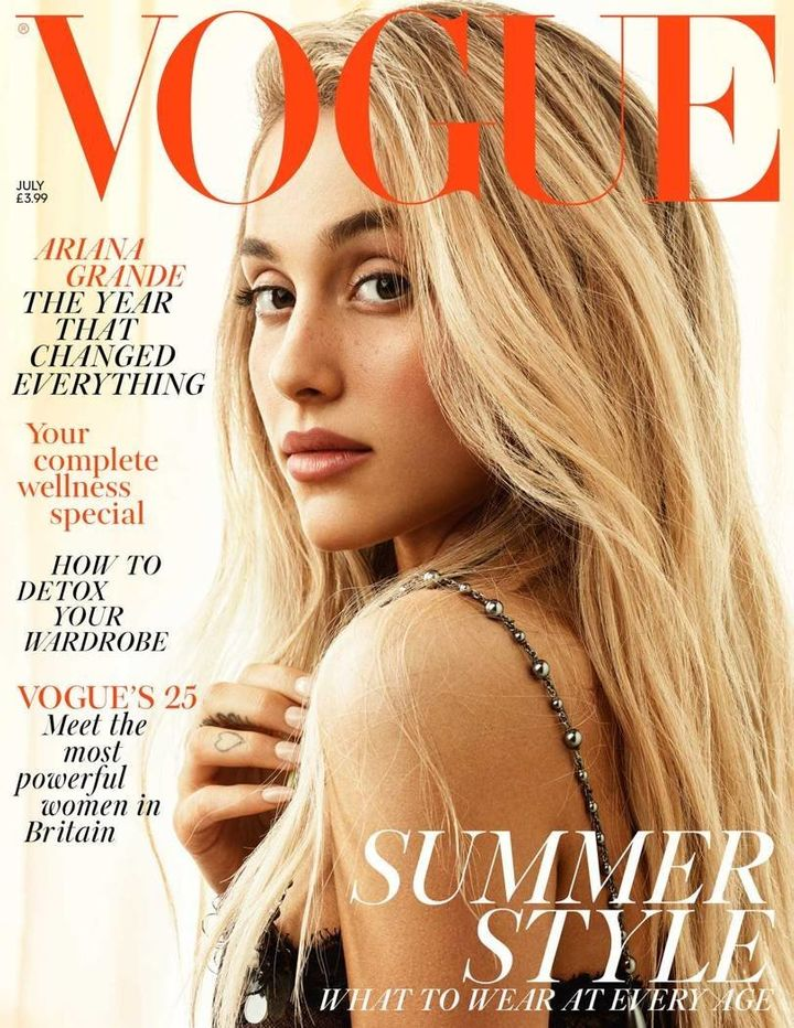 Grande wears a black lace dress on the cover, complete with metallic-like straps.