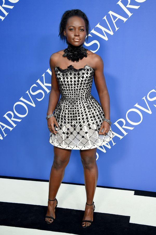 The Oscar-winning actress wore a Versace mini dress.