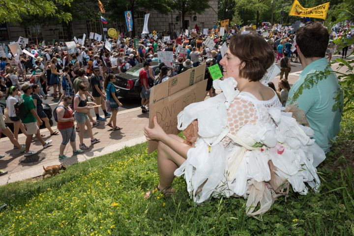 Kathryn Ravey of Falls Church, Virginia, calls for a plastic bag tax at the People's Climate March in Washington, D.C. in Apr