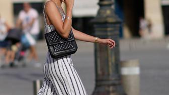PARIS, FRANCE - MAY 27:  A passerby wears a black bag, striped pants, on May 27, 2018 in Paris, France.  (Photo by Edward Berthelot/Getty Images)