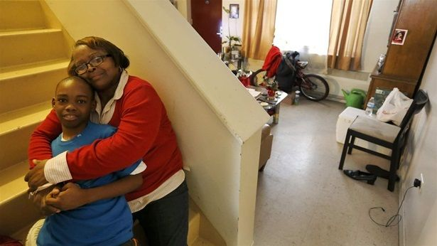 Debra Aldridge poses with her grandson, Mario Hendricks, at her home on Chicago's South Side. Nationwide, millions of grandpa