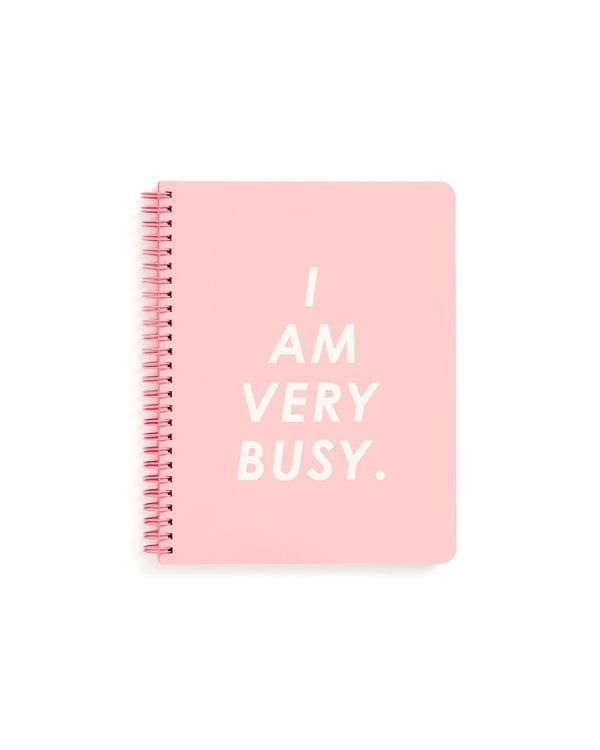 """$12, get it <a href=""""https://www.bando.com/collections/desk-stationery/products/rough-draft-mini-notebook-i-am-very-busy-pink"""