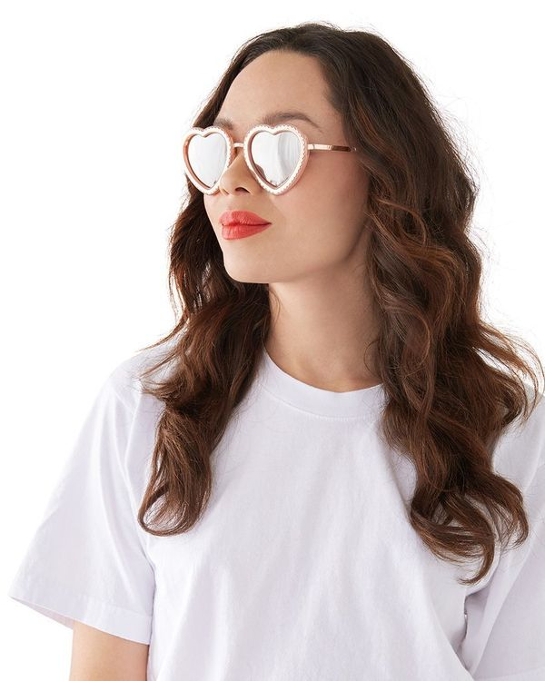 """$15, get it <a href=""""https://www.bando.com/collections/sunglasses/products/rose-gold-scalloped-heart-sunglasses"""" target=""""_bla"""