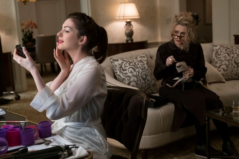 Hathaway doing her own makeup for the damn Met Gala while Bonham-Carter (like all of us) looks on