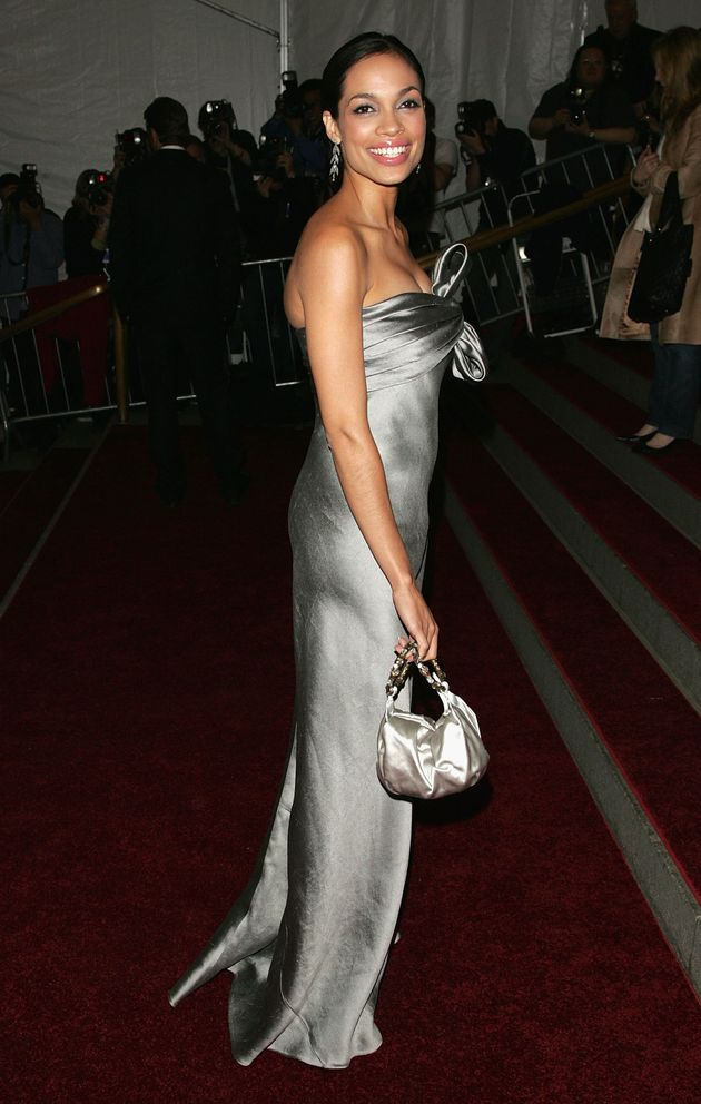 Rosario Dawson carrying a Kate Spade purse at the Met Gala in
