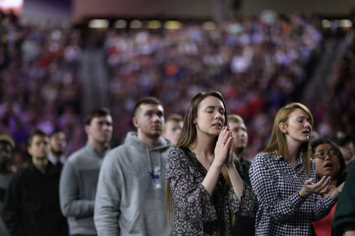 Thousands of students, supporters and invited guests sing Christianpraise songs before then-candidate Donald Trump&nbsp