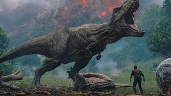 """Owen (CHRIS PRATT) meets the vicious T. rex in """"Jurassic World: Fallen Kingdom.""""  When the island's dormant volcano begins roaring to life, Owen and Claire (BRYCE DALLAS HOWARD) mount a campaign to rescue the remaining dinosaurs from this extinction-level event.  Welcome to """"Jurassic World: Fallen Kingdom."""""""