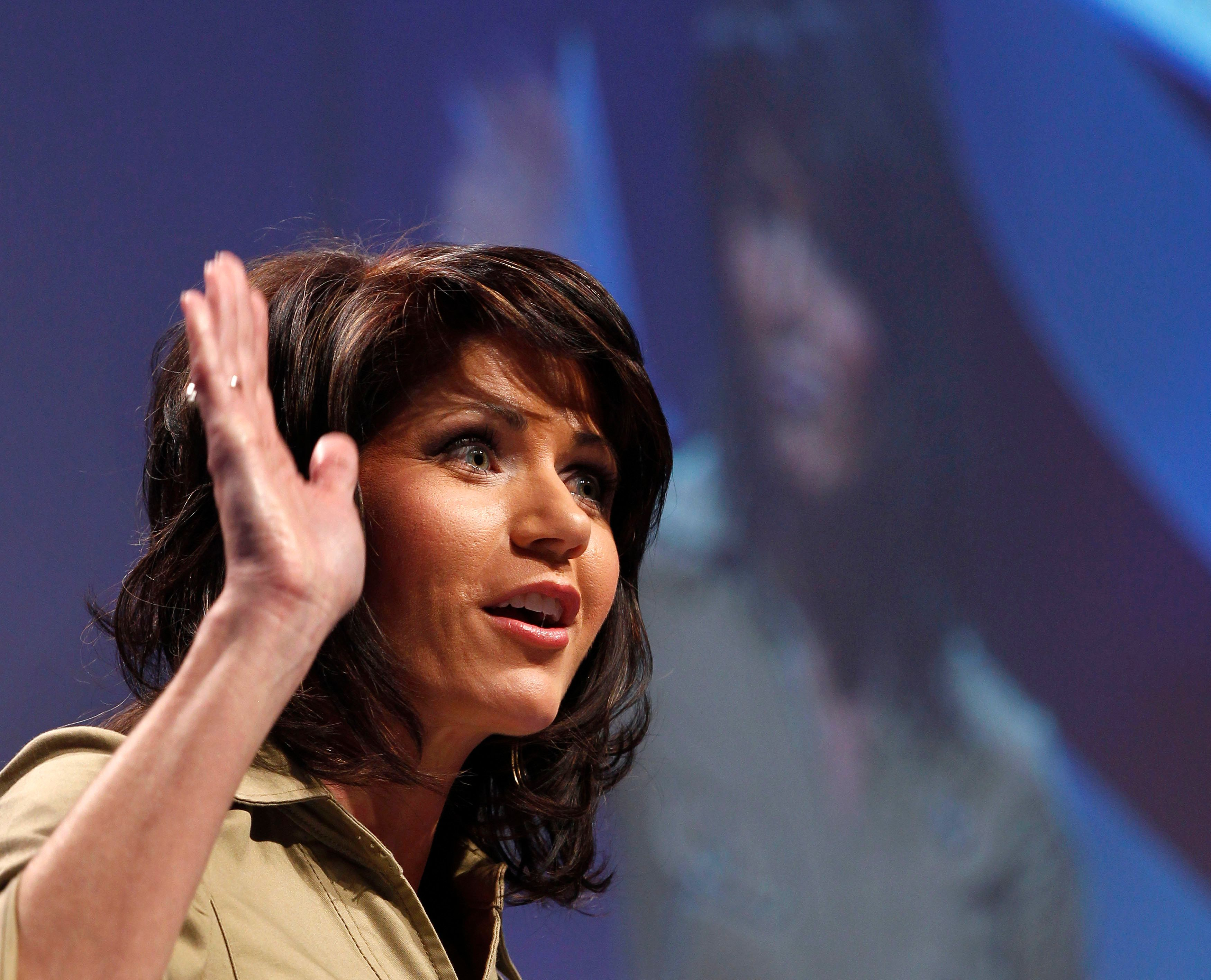 U.S. Representative Kristi Noem (R-SD) gestures while speaking to the 38th annual Conservative Political Action Conference meeting at the Marriott Wardman Park Hotel in Washington, February 10, 2011. The CPAC is a project of the American Conservative Union Foundation. REUTERS/Larry Downing (UNITED STATES - Tags: POLITICS)