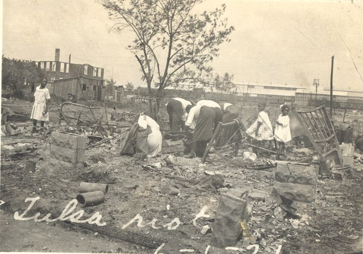 Black residents searchthrough rubble after the Tulsa Race Riot of June 1921.