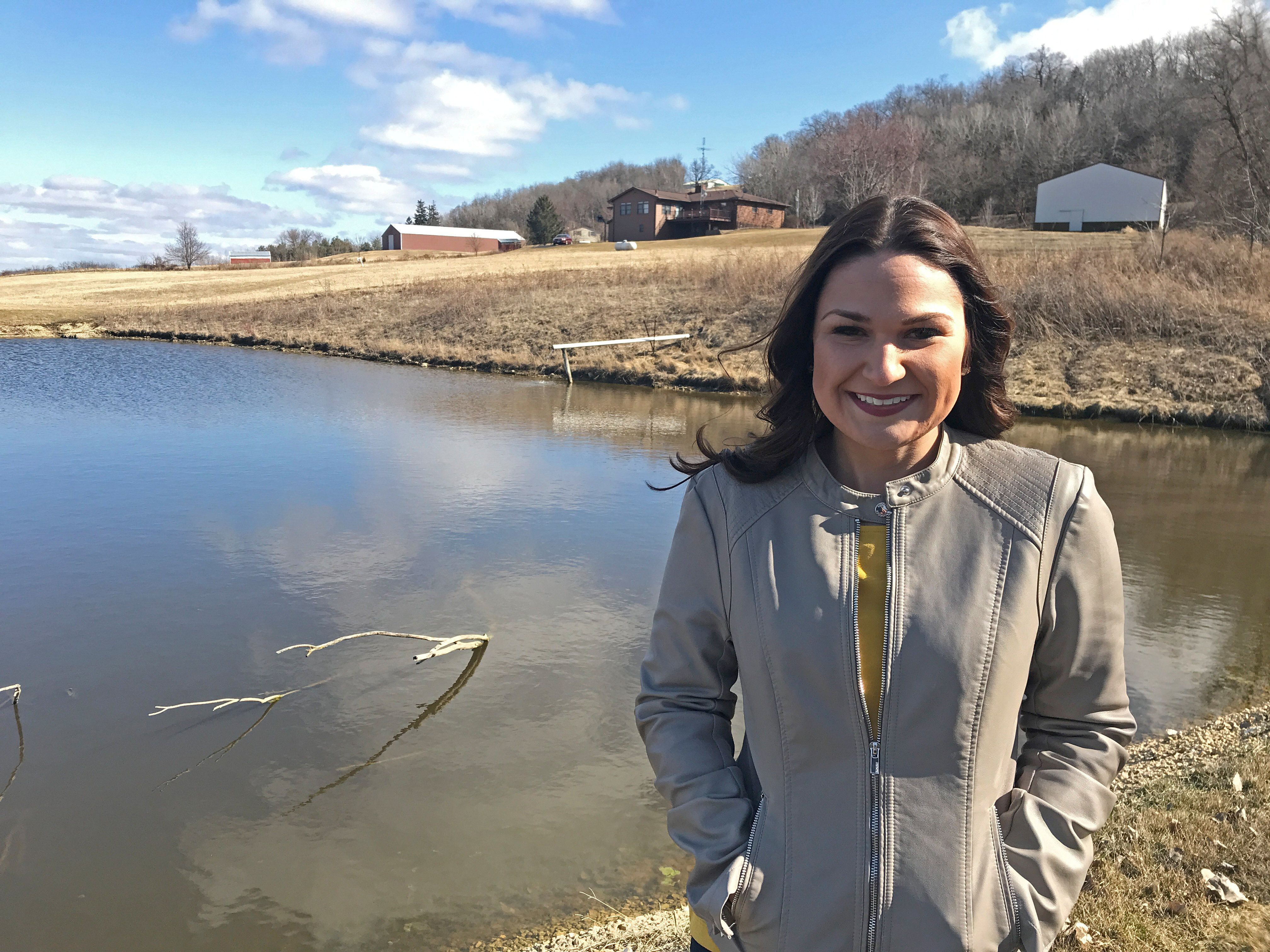 Abby Finkenauer, a Democratic candidate trying to unseat Republican incumbent Rod Blum in Iowa's 1st congressional district, is pictured on the grounds of the house in which she grew up in Sherril, Iowa, U.S. March 31, 2018. Picture taken March 31, 2018. REUTERS/Tim Reid