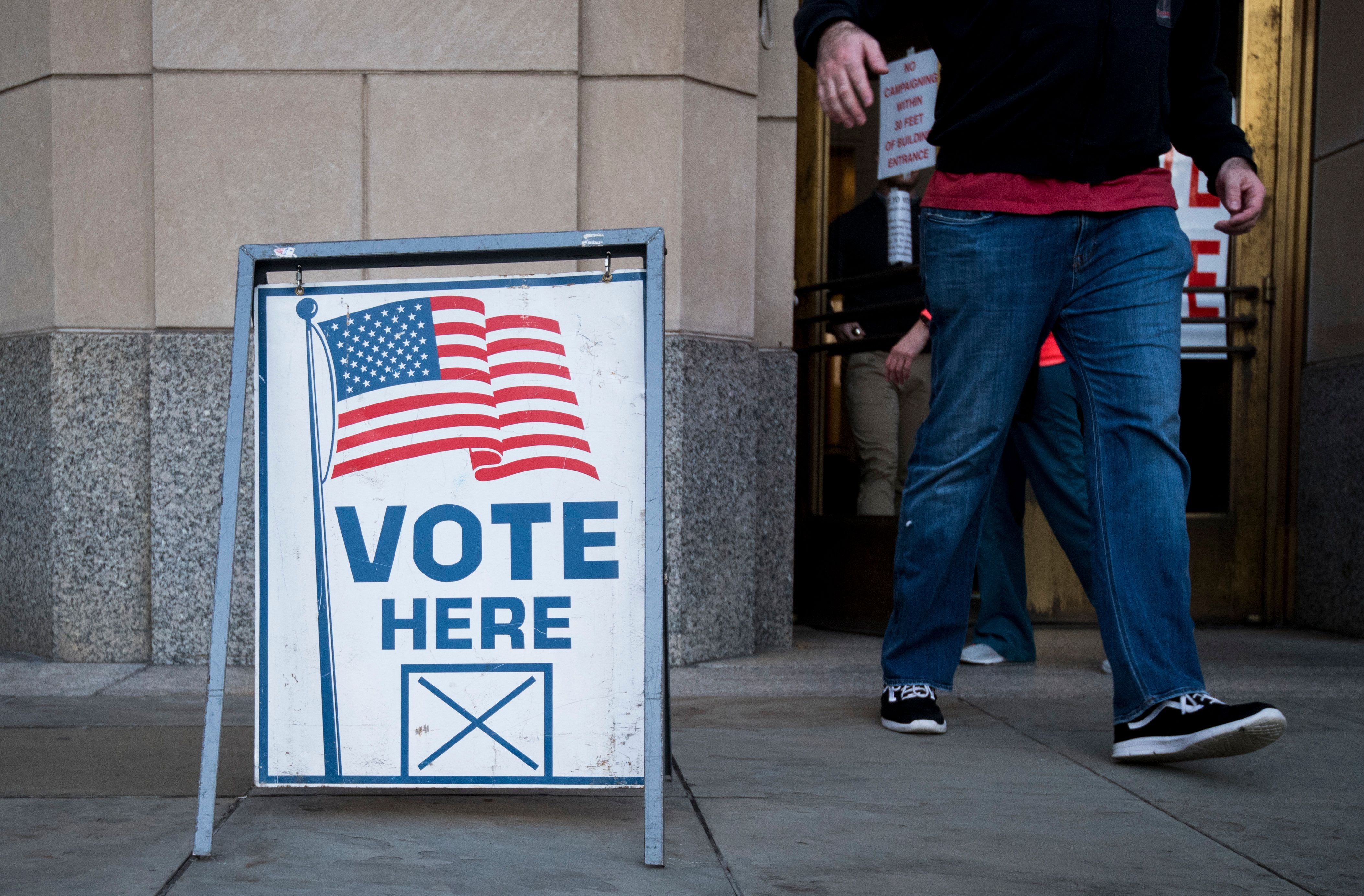UNITED STATES - DECEMBER 11: Voters exit the polling station at the Jefferson County Courthouse in Birmingham, Ala., on Tuesday, Dec. 12, 2017, after voting in the special election to fill Jeff Sessions' seat in the U.S. Senate. (Photo By Bill Clark/CQ Roll Call)