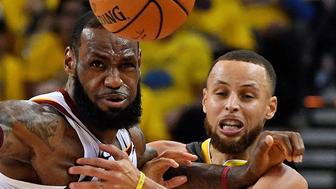 June 3, 2018; Oakland, CA, USA; Golden State Warriors guard Stephen Curry (30) and Cleveland Cavaliers forward LeBron James (23) go for a loose ball during the second quarter in game two of the 2018 NBA Finals at Oracle Arena. Mandatory Credit: Kyle Terada-USA TODAY Sports