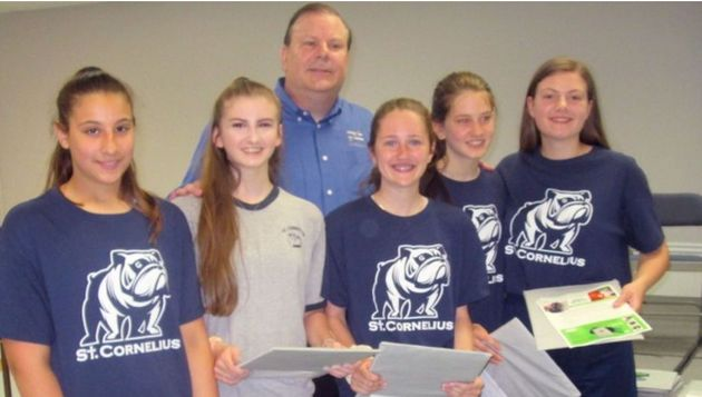 Students atSt.Cornelius School pose with the ballistic shields they were gifted by...