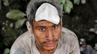 A man covered with ash after the eruption of the Fuego volcano is seen at an area affected in the community of San Miguel Los Lotes in Escuintla Guatemala June 5 2018