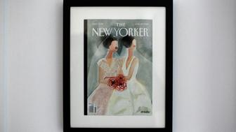 A framed New Yorker magazine cover hangs in the home of same-sex married couple Heather Morgan, an American, and Maria del Mar Verdugo, from Spain, in Manhattan, New York December 2, 2012. The Defense of Marriage Act, known as DOMA, blocks federal recognition of same-sex unions. In the United States there are at least 28,500 bi-national same-sex couples in which one partner is a U.S. citizen and one is not, and the couples live with the threat that one of them could be deported. Picture taken December 2, 2012.   REUTERS/Allison Joyce (UNITED STATES - Tags: POLITICS SOCIETY)