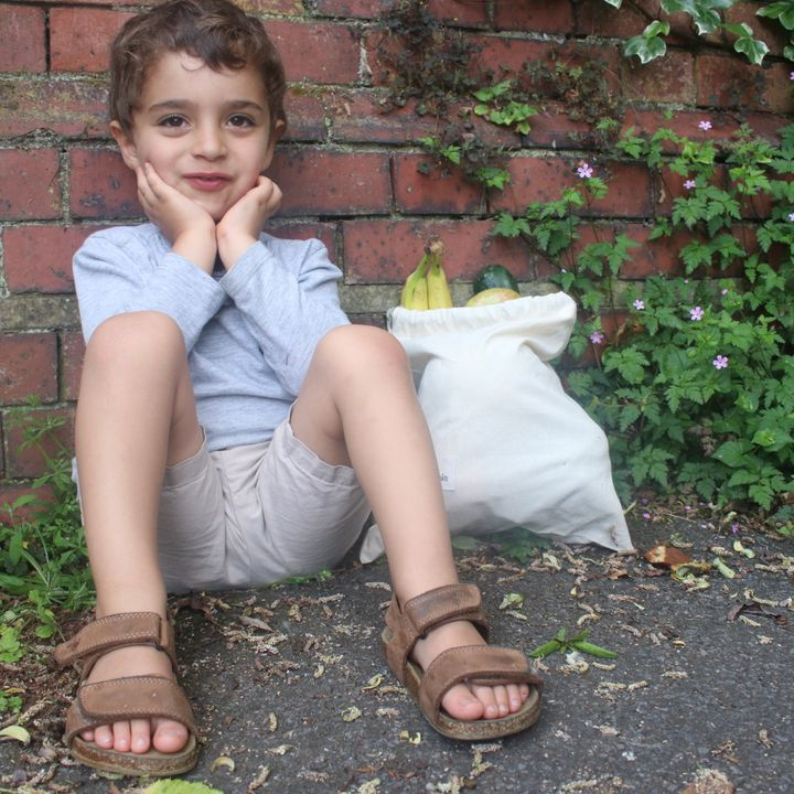 Four-year-old Jack takes his own canvas bag to the supermarket.