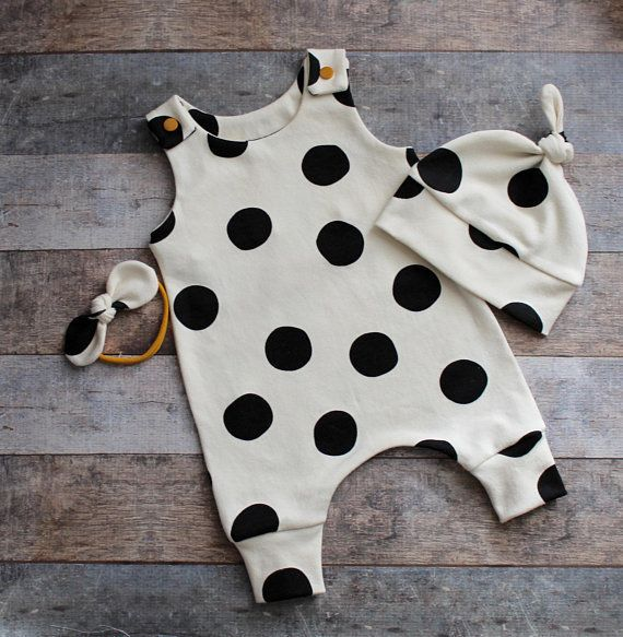 """Shop them <a href=""""https://www.etsy.com/listing/609741825/organic-unisex-black-and-cream-dot-baby?ref=shop_home_active_53"""" ta"""