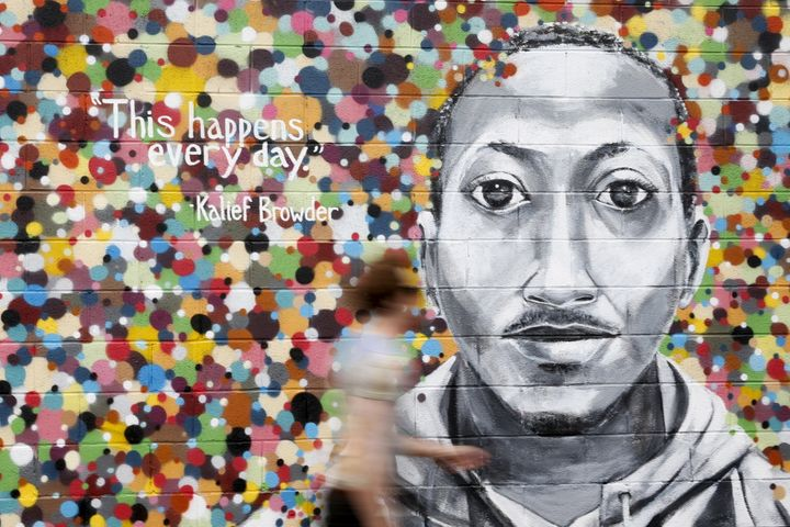 A man walks by a mural honoring Kalief Browder in Queens, New York, June 16, 2015.